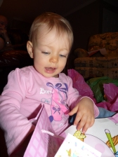 Iona opening her birthday gifts.