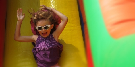 Ava heading down the jumping castle slide